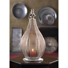 Look no further for a stunning candle accessory that will instantly increase the style factor in any room. Our Metal Rattan Lantern features a stunning pear-shaped design with an intricate rattan-style woven pattern that will enhance the...