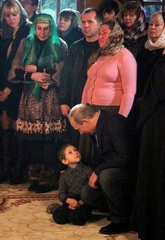 First Photo: Russian President Vladimir Putin scaring kid during a religious service in the church, have become viral on the Internet