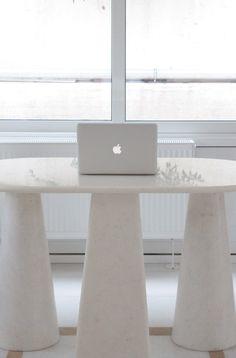 Apple excuse on Naxos Crystalline marble desk.