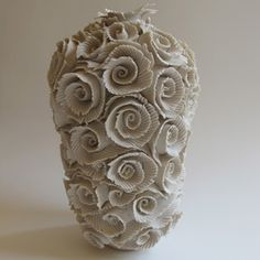 I thought that this was a really cool coiled pottery piece. The roses on the outside add a textural dimension  that my other piece did not have. I think that the roses outside are very pretty, and I think that it is interesting how many different techniques there are for coil pottery.