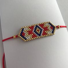 EMMA – Red and blue Bracelet - ideas sobre tecnología, diseño, calzado, vacaciones Loom Bracelet Patterns, Bead Loom Bracelets, Bead Jewellery, Beaded Jewelry, Handmade Jewelry, Bead Bottle, Bracelets Bleus, Rakhi Design, Motifs Perler