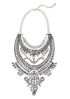 This over the top glamorous statement necklace features lots of details and rhinestones. It is perfect for high neck dresses as it will become the focal the point.