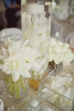 Ooh I love the middle vase with the orchids and the candle floating on top. Pretty.
