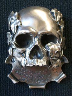 Memento mori skull wall bottle opener.