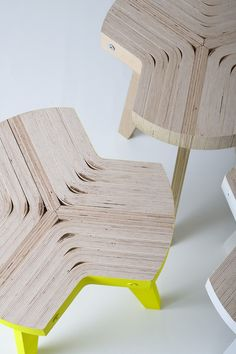 Offset flatpack stool designed by Giorgio Biscaro. The seat is made from slices of one sheet of bent plywood, then attached to three metal legs.
