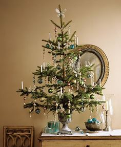 mini Christmas tree- I love the color scheme and the openness of the decoration, for a full size tree as well
