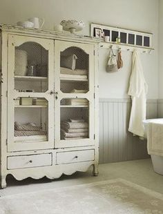 re-purposed armoire for bathroom.  you could use the tv hutch you got for dishes in the new room, or redo it with the cut outs in your downstairs bathroom (if there is room) #food