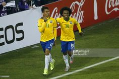 Roberto Firmino of Brazil celebrates with teammate Willian after scoring the second goal of his team during the 2015 Copa America Chile Group C match between Brazil and Venezuela at Monumental David Arellano Stadium on June 21, 2015 in Santiago, Chile.