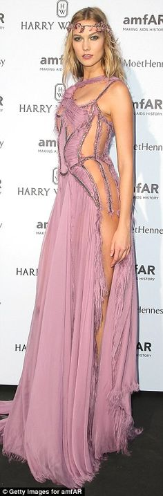 Taking it to the streets: Karlie then showed off Donatella Versace's hard work as she mode...
