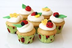Fondant lady bugs. @Cara Fuller these would be cute using the grass frosting tip