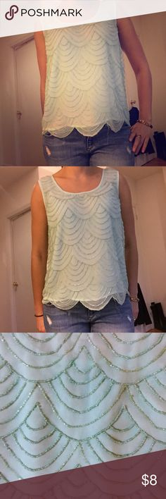 Aqua Beaded Tank Top Aqua Beaded Tank Top. Beading forms a scalloped pattern on the front and back. Forever21. Gently worn. Some slight fraying of the beads on right sleeve. Forever 21 Tops Blouses