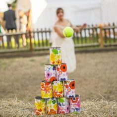 Rustic wedding in a marquee in a quaint English pub with Bride in printed 50s style gown and lots of colourful details and garden games