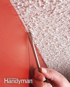 Get a neat, straight paint line at the top of a wall that is next to a textured ceiling by dragging a narrow, flat-headed screwdriver lightly along the ceiling. You'll get a clean paint line and no one will ever notice that the bumps are missing
