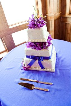 Square cake with dot detailing and garnished with purple orchids. Photo by Daniel Pullen Photography  www.engagingeventsobx.com #engagingeventsobx #beachwedding