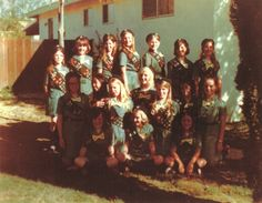 """Girl Scouts at 100: Still 'courageous and strong' - The Orange County Register. """"I prayed the many times we spent together provided many memories for the 17 girls of Troop 516.  Also the badges we worked on provided skills for their future.""""  Mary Ann Mecke, Orange, speaking of the troop of Girl Scouts she led in the early 1970s.  Photo of the troop taken in the family's backyard."""