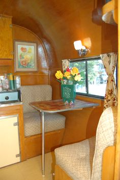 Restored dining table and upholstered benches in 1948 Terry Rambler Trailer