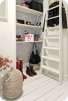 Is this not a fabulous closet with the wallpapered back?