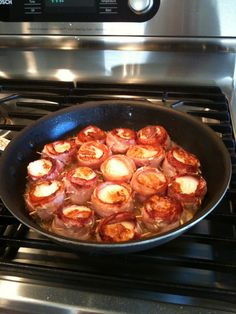 Bacon Wrapped Scallops.  I made this but I broiled it for about 20 minutes rather than cooking it on the stovetop.  I flipped it at ten minutes.  Everyone scarfed them down :)