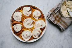 Pumpkin Cinnamon Rolls with Orange Cream Cheese Icing