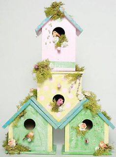 I absolutely love decorating birdhouses! It's one of my favorite craft activities for spring and summer. I see unfinished wood birdhouses everywhere, just begging for a coat of paint or some paper decoupaged...