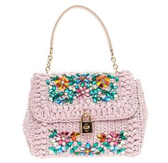 Dolce & Gabbana Miss Bonita Bag. Crafted in lilac woven straw and embellishments, opening to a striking leopard print fabric interior $815