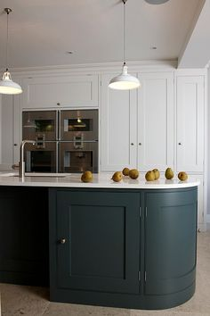 A Bespoke Kitchen in Holland Park, London by Tim Moss Kitchens. Gaggenau appliances, Farrow & Ball Skimming Stone and Downpipe colours, Ceasarstone Organic White worktops, Dornbracht Elio taps