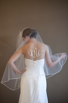 Okay, so this gave me a beyond fantastic idea-figure out a way to have your OLD initials showing as you walk down the aisle, then when your husband flips the veil, have the NEW ones showing as you walk out!!!!! :D :D :D