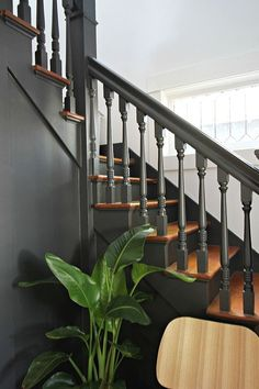 Traditional Entryway Is Completely Modernized With Just 2 Easy Changes You can give your staircase a quick update with a new paint job.You can give your staircase a quick update with a new paint job. Modern Staircase, Staircase Design, Staircase Diy, Rustic Staircase, Traditional Staircase, Staircase Remodel, Banisters, Stair Railing, Benjamin Moore Wrought Iron