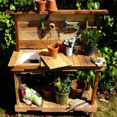 Rustic potting bench made using upcycled pallet wood. DYI! Anyone can build this.