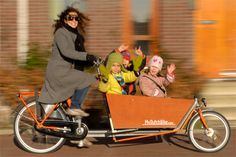 Bakfiet: a dutch bike with super-capacity cargo space!  I need to get one of these to replace my gas consuming car.