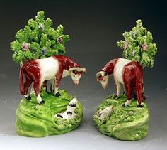 Antique Staffordshire Pottery Figures Of Standing Cows With Bocage  | From a unique collection of antique and modern models and miniatures at http://www.1stdibs.com/furniture/more-furniture-collectibles/models-miniatures/