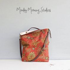 This listing is for the SMALL sized bag - a larger version can be found here http://etsy.me/2wjyOkf Convertible foldover purse that can be used as a messenger bag, shoulder bag or tote. Made of a quality linen blend drapery fabric printed with a fabulous vintage style floral