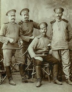 1910s Slavic faces of Russian officers. They bear the mustache as the Tsar, pair of boots and traditional blouses, as are all men in Russia, simply embellished with epaulets