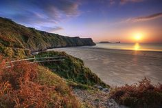Sunset, Rhosilli Bay ~ Gower Peninsula, South Wales [photo by Jibbo via Flickr]....