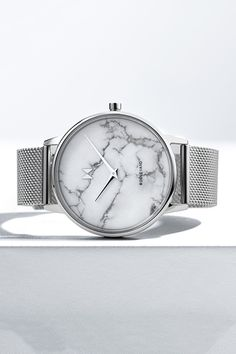 silver stainless steel watch with a white marble face on a white surface Mvmt Watches, Big Watches, Sport Watches, Cool Watches, Watches For Men, Marble Watch, Iconic Women, Watch Case, Stainless Steel Watch