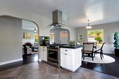 Island range with arched glass hood vent