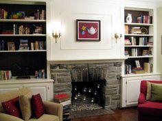 Fireplace flanked by built-in bookshelves - photo credit: lipstickalleydotcom.jpg