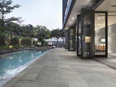 revêtement de terrasse en carreaux de ciment de bourgogne, aspect pierre