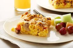 This cheesy brunch bake with onions, mushrooms, tomatoes and sausage smells so good as it bakes, they'll be at the table before the first cup of coffee.