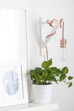 DIY metallic wall sconce with an Edison Light Bulb.
