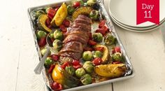 Bacon-Wrapped Pork Tenderloin with harvest vegetables                  p