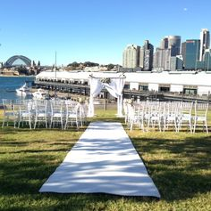 Ceremony setup at Giba Park in Pyrmont. Setup included a Bamboo canopy with white chiffon and a fresh floral arrangement at the top, plush white carpet and white tiffany chairs. Vitra Chair, Knoll Chairs, Park Weddings, Wedding Events, Wedding Ceremony, Home Goods Chairs, Tiffany Chair, Types Of Wedding Cakes, Wedding Canopy
