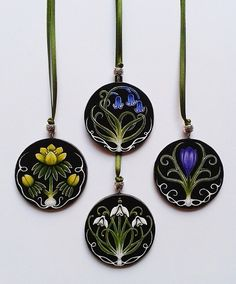 Hand painted wooden pendant, strung with an ornamental bead on green satin ribbon.Choose from Snowdrop, Bluebell, Winter Aconite, or Crocus designs.Pendant size diameter: 5cmPendant depth: 3mmRibbon width: 3mmRibbon length: 64cm approx.
