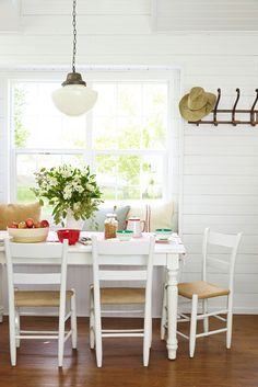 When the owner of this DIY Wyoming home spied this table at The Salvation Army, it had a 1980s orangey-maple top, but white paint made it marvelous.   - CountryLiving.com
