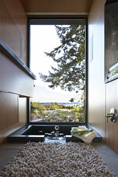 a bathroom with an incredible view