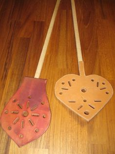 Fly-swatter, leather and wood by Sophia Aisinger
