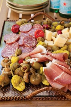 Italian Antipasti Platter with Parmesan cheese, pepperoncini and cherry peppers, olives, marinated mushrooms, prosciutto, and Italian dry sausage
