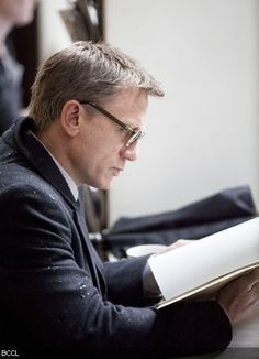 Daniel Craig reading - didn't think he could be made more attractive than he already is, but I was wrong.