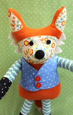 """Sewing Pattern Includes: Instructions and pattern pieces for a stuffed fox. Finished Size 18"""" tall Suitable Fabrics: Quilting weight cotton broad- cloth, felt,"""