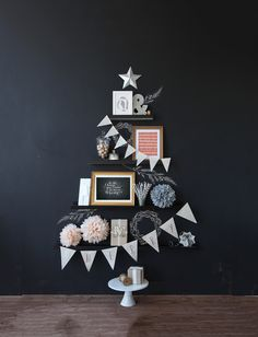 Create a Christmas Tree on your wall with decorative elements like bunting…